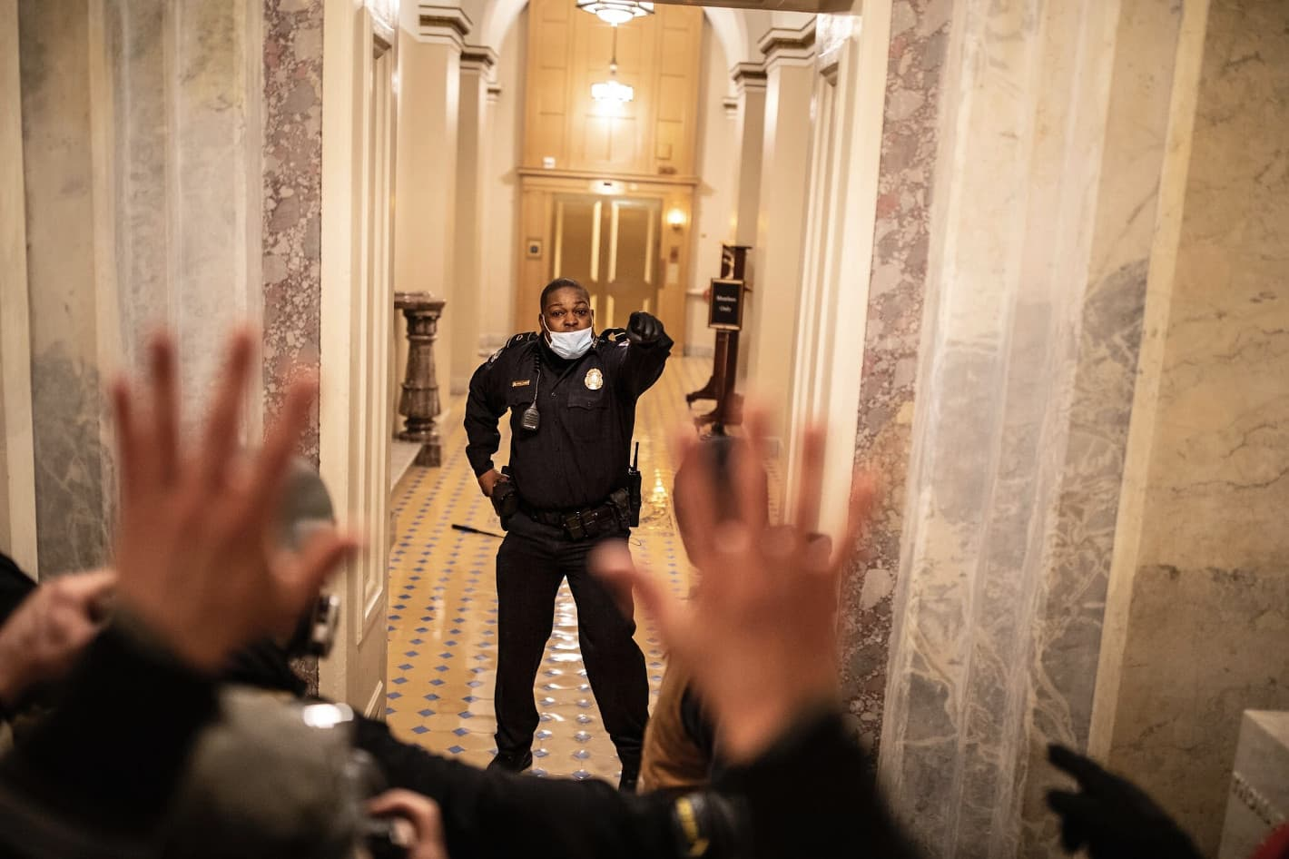 Officer Eugene Goodman facing down insurrectionists in the US Capitol invasion